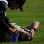 トレーナーと怪我した選手